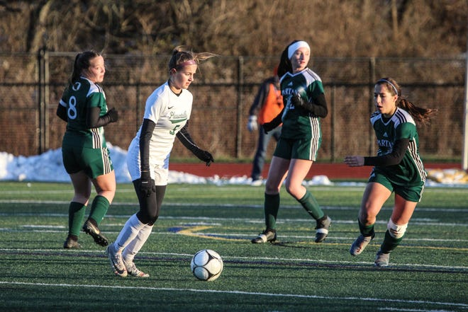 Pleasantville's Allison Portera surveys the field before making a pass during the NYSPHSAA Class B girls soccer state semifinal at Cortland High School on Saturday, Nov. 16, 2019.
