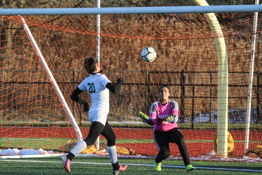 Greece Olympia's Dimora Giana prepares to make a save, as Pleasantville's Izzy Kapoor charges the net during the NYSPHSAA Class B girls soccer state semifinals at Cortland High School on Saturday, Nov. 16, 2019.