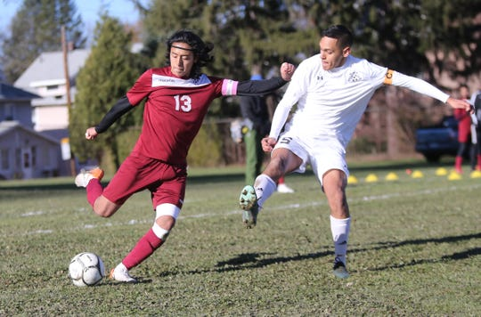 Ossining's Ronald Suscal (13) works past the Jericho defense during their 1-0 double overtime loss in the NYSPHSAA boys soccer semi-finals at Twin Towers Middle School on Saturday, November 16, 2019.