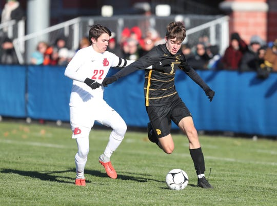 Greece Athena's Ryan Fitzgerald (3) works the ball during their 2-0 win over Jamesville-Dewitt in the NYSPHSAA boys soccer semifinals at Middletown High School on Saturday, Nov. 16, 2019. Fitzgerald scored the first of Athena's goals.