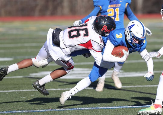 Ardsley's Preston Wachtell (3) is stopped by Port Jervis' Elijah Shearn (16) in the Class B semifinal at Mahopac High School Nov. 16, 2019. Port Jervis won the game 20-14.