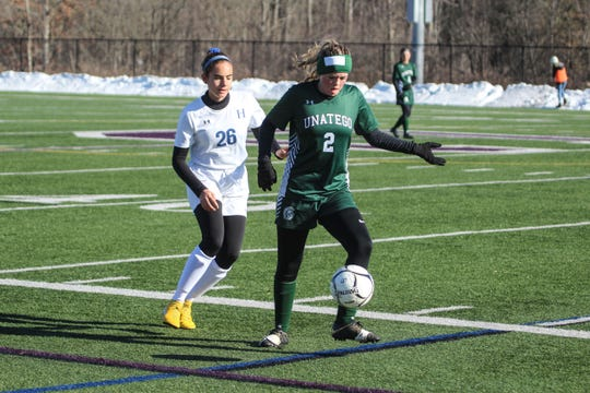 Unatego's Kylie Mussaw shields the ball from Haldane's Anna Rowe in the NYSPHSAA Class C girls soccer state semifinals at Cortland High School on Saturday, Nov. 16, 2019.