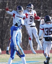 Port Jervis' Noah Brown (5) and Robert Filancia (9) celebrate a second half touchdown in front of Ardsley's Andrew DeGuardia (8) in the Class B semifinal at Mahopac High School Nov. 16, 2019. Port Jervis won the game 20-14.