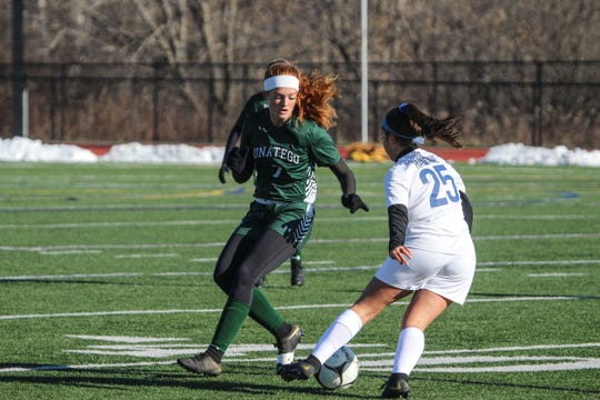 Haldane's Allie Ferreira attempts to dribble past Unatego's Leah Hamm in the NYSPHSAA Class C girls soccer state semifinal match at Cortland High School on Saturday, Nov. 16, 2019.