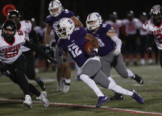 New Rochelle's Jessie Parson (12) runs for a first half touchdown against Proctor during the Class AA semifinal at Mahopac High School Nov. 16, 2019.