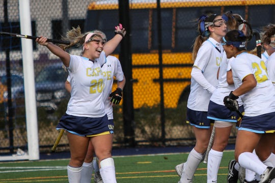 Cape Henlopen's Cameron Smith celebrates a goal in the Delaware division one field hockey championship game against Padua. Cape Henlopen came away victorious, with a score of 2-0.