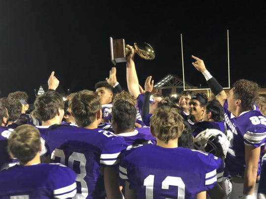 The Jacksboro Tigers celebrate a Region II-3A Division II bi-district championship after routing Henrietta on Friday, Nov. 15, 2019.