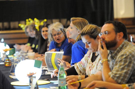 Competitors line the main tables prior to the start of the Adult Spelling Bee, held at The Forum on November 15, 2019.