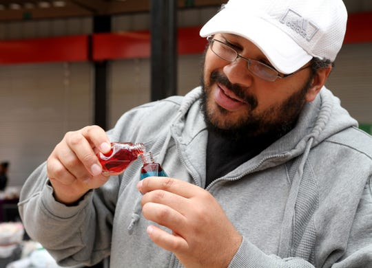 Robert Richards, personal fragrance oils by Ummberrto, sells perfumes he made Saturday, Nov. 16, 2019, at the downtown Wichita Falls Farmers Market.