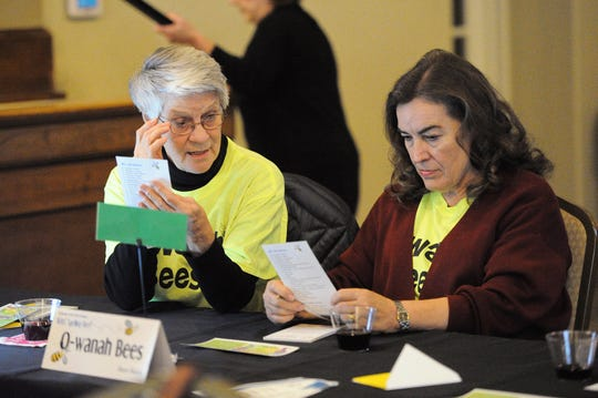 "The ""O-wanah Bees"" team, consisting of Peggy Cline, Linda Cook, and Ann Hunter, practice their words prior to the start of the competition. The team went on to win the annual Wichita Adult Literacy Council's Adult Spelling Bee by correctly spelling einkorn, a wild species of wheat."