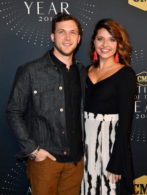 Phillip Phillips and wife Hannah Blackwell on the red carpet before the 2017 CMT Artists of the Year show on Oct. 18, 2017 in Nashville.
