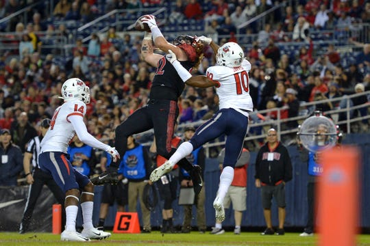 San Diego State tight end Parker Houston leaps during an attempt to catch a pass against Fresno State.