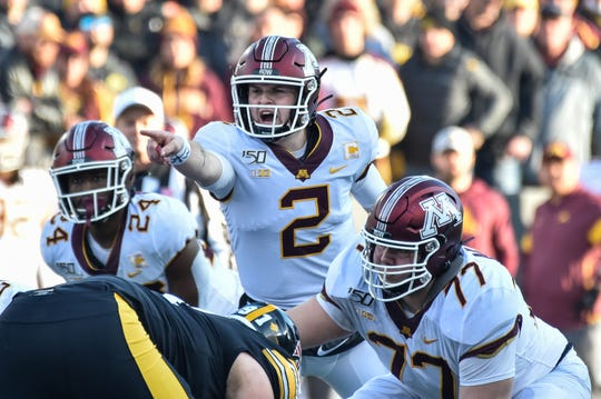 Minnesota Golden Gophers quarterback Tanner Morgan directs the offense against the Iowa Hawkeyes during the first quarter at Kinnick Stadium in Iowa City.