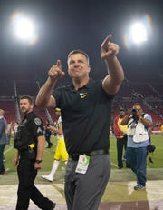 Oregon head coach Mario Cristobal celebrates a victory over Cal.