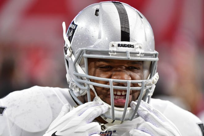 Oakland Raiders linebacker Vontaze Burfict looks on during a preseason game.