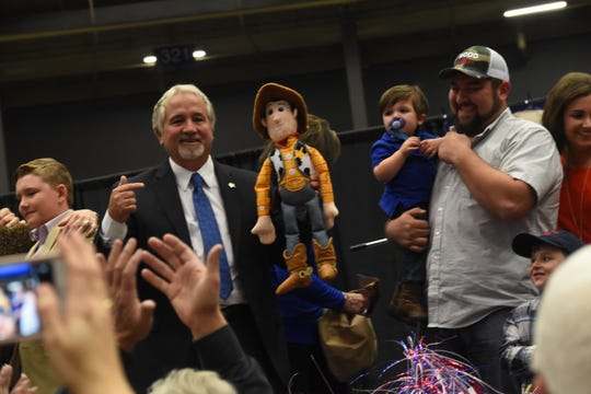 "Mark Wood (left), holding a Sheriff Woody doll from the Disney movie ""Toy Story"" and surrounded by family members at his watch party held at the Rapides Parish Coliseum, won the election for Rapides Parish Sheriff with 51 percent over his opponent Kris Cloessner."
