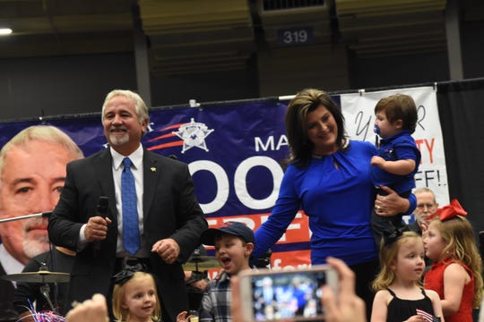 Mark Wood (left) , with his wife Tonya, is surrounded by family members on stage at his watch party held at the Rapides Parish Coliseum. Wood won the election for Rapides Parish Sheriff with 51 percent over his opponent Kris Cloessner.