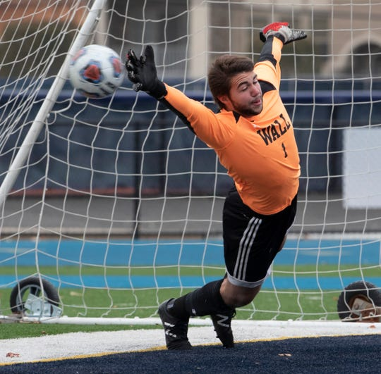 Wall goalie Sebastian Campanile stretches out but can't stop a penalty shot in overtime. Wall Boys soccer team vs. Millburn in the NJSIAA Group III State Final in Union, NJ on November 17, 2019.