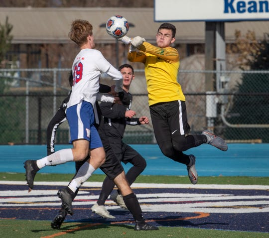 Wall Jake Pepe tries for a goal as Milburn goalie  Zach Barr works  to stop him. Wall Boys soccer team vs. Millburn in the NJSIAA Group III State Final in Union, NJ on November 17, 2019.