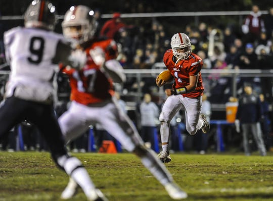 Wall junior quarterback/defensive back Logan Peters, shown running the ball last Friday night in the Crimson Knights'  35-18 win over Lacey in a NJSIAA Central Group III semifinal, is one of the candidates readers can vote for in the Asbury Park Press Shore Conference Player of the Week Poll