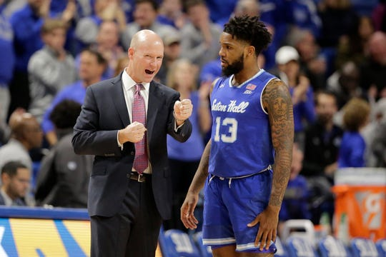 Seton Hall head coach Kevin Willard, left, talks with guard Myles Powell (13) during the first half of an NCAA college basketball game against Saint Louis, Sunday, Nov. 17, 2019, in St. Louis. (AP Photo/Jeff Roberson)