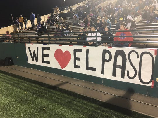 A banner declaring love for the city of El Paso displayed during the playoff football game Friday between the Abilene Cooper Cougars and the El Paso Del Valle Conquistadors. It was displayed just hours after a pep rally sign hanging in the Cooper gymnasium painted what some feel was a starkly different message.