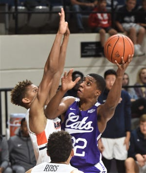 ACU's Joe Pleasant, right, shoots over a Pepperdine defender during last season's game at Moody Coliseum.