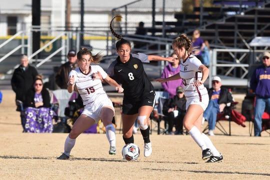 Hardin-Simmons forward Taylor Bernal (8) battles a pair of Trinity defenders for the ball during the second round of the NCAA Division III women's soccer tournament at the HSU Soccer Complex on Sunday, Nov. 17, 2019.