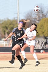 Hardin-Simmons midfielder Morgan McAdams (20) wins a header over against a Trinity defender during the second round of the NCAA Division III women's soccer tournament at the HSU Soccer Complex. Another great HSU season came to an end with a 2-0 loss.
