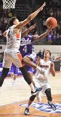 ACU's Damien Daniels (4) drives against Pepperdine's Colbey Ross for what would have been the game-tying basket with seven seconds left in the game. It didn't fall, and the Waves hit two free throws at the other end in a 73-69 victory over the Wildcats on Saturday, Nov. 16, 2019, at Moody Coliseum.