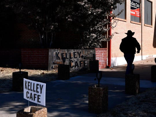 Diners approach the entrance to Kelley Cafe, located in the former Kelley Elementary School, in Colorado City Thursday.