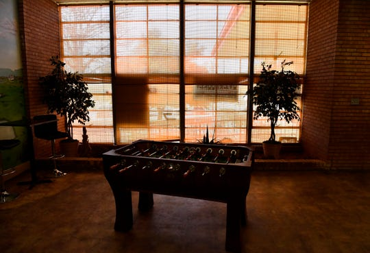 A foosball table stands in the lobby of the former Kelley Elementary School in Colorado City. The building is now a restaurant and small business center.