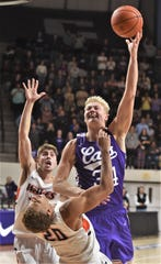 ACU's Kolton Kohl (34) is fouled by Pepperdine's Kameron Edwards with 1:21 left in the game. Kohl made both free throws, pulling the Wildcats within one (69-68). But Colbey Ross hit a layup at the other end, and the Waves held on to beat ACU 73-69 in the nonconference game Saturday, Nov. 16, 2019, at Moody Coliseum.