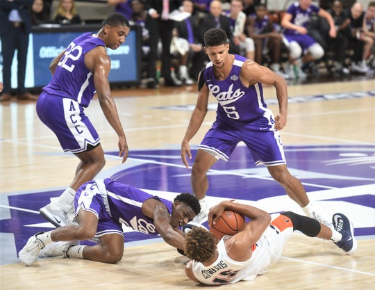 An ACU player battles Pepperdine's Kessler Edwards for a loose ball as Joe Pleasant (32) and Payten Ricks (5) look on during the first half of the nonconference game Saturday, Nov. 16, 2019, at Moody Coliseum.