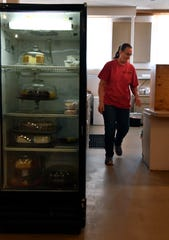 Brenda Hammond walks past the dessert cooler at Kelley Cafe in Colorado City on Thursday.