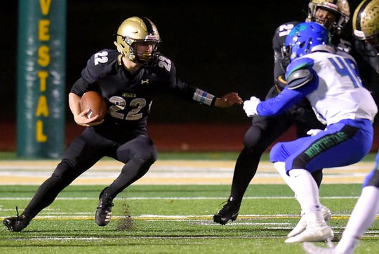 Max Freeman (22) of Corning looks to get past Dennis Green (48) of CNS during Cicero-North Syracuse vs. Corning, Class AA regional football at Vestal Central School District, Saturday, November 16, 2019.