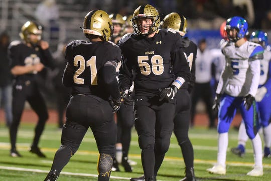 Corning's Ja'Ovian Fisher (21) and Jake Townsand (58) during CiceroÐNorth Syracuse vs. Corning, Class AA regional football at Vestal Central School District, Saturday, November 16, 2019.
