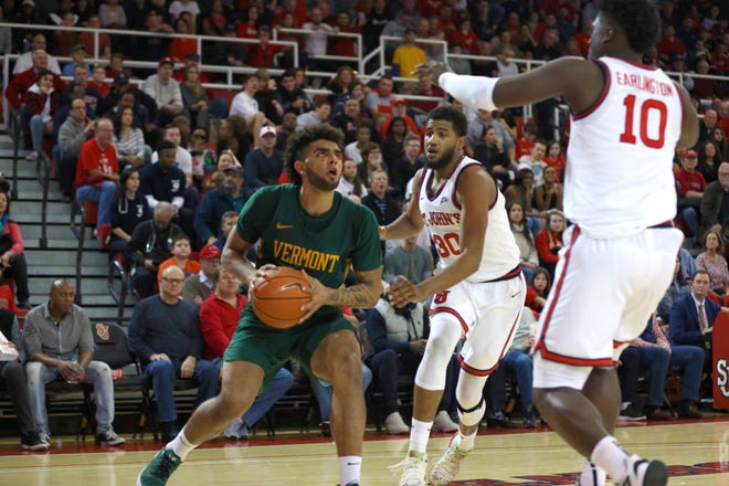 UVM forward Anthony Lamb goes up for two in the 70-68 victory over St. John's on Saturday.