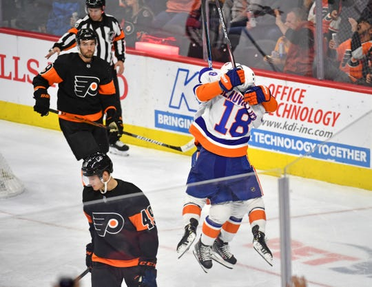 Nov 16, 2019; Philadelphia, PA, USA; New York Islanders left wing Anthony Beauvillier (18) celebrates his game tying goal with center Derick Brassard (10) lduring the third period against the Philadelphia Flyers at Wells Fargo Center. Mandatory Credit: Eric Hartline-USA TODAY Sports