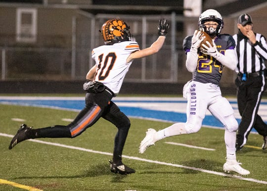 Bloom-Carroll's Evan Willett catches a touchdown pass during a 49-21 win over Waverly in a Division IV regional semifinal game in Chillicothe, Ohio, on Nov. 16, 2019.