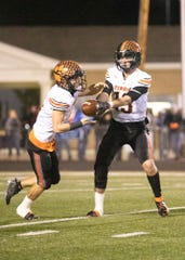 Waverly quarterback Haydn' Shanks hands the ball off to Payton Shoemaker during a 49-21 loss to Bloom-Carroll in a Division IV regional semifinal game in Chillicothe, Ohio, on Nov. 16, 2019.