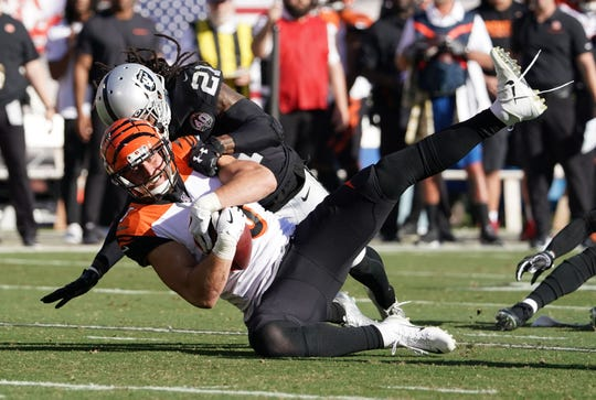 Nov 17, 2019; Oakland, CA, USA; Cincinnati Bengals tight end Tyler Eifert (85) is tackled by Oakland Raiders free safety D.J. Swearinger (21) in the first quarter at Oakland-Alameda County Coliseum.