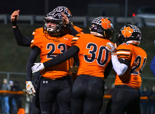 Lawrenceburg defenders celebrate a stop against Heritage Hills during a IHSAA Playoff game at Lawrenceburg High School, Saturday, Nov. 16, 2019