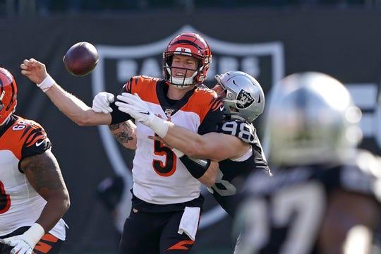 Nov 17, 2019; Oakland, CA, USA; Oakland Raiders defensive end Maxx Crosby (98) forces a fumble by Cincinnati Bengals quarterback Ryan Finley (5) during the first quarter at Oakland Coliseum.