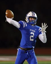 Wyoming quarterback Evan Prater attempts a pass in the OHSAA playoff game between Indian Hill and Wyoming at Princeton High School Nov. 16, 2019.