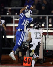 Wyoming wide receiver Joop Mitchell makes a leaping catch for a big gain in the OHSAA playoff game between Indian Hill and Wyoming at Princeton High School Nov. 16, 2019.