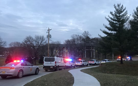 At least a dozen police vehicles are on the scene of an active shooter who barricaded himself in an apartment on East Douglas Avenue.