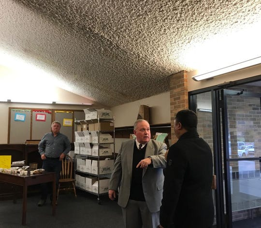 Pastor John Kline greeting guests before Sunday service and the celebration of Zion Lutheran Church's 160th anniversary on Nov. 17, 2019 in Des Moines.
