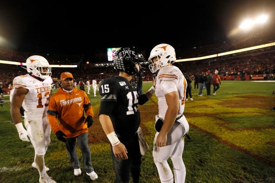 Iowa State quarterback Brock Purdy (15) talks with Texas quarterback Sam Ehlinger, right, after an NCAA college football game, Saturday, Nov. 16, 2019, in Ames, Iowa. Iowa State won 23-21. (AP Photo/Charlie Neibergall)