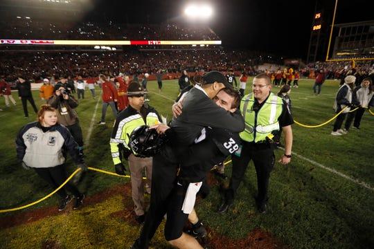 Iowa State head coach Matt Campbell celebrates with defensive lineman Steve Wirtel (39) after an NCAA college football game against Texas, Saturday, Nov. 16, 2019, in Ames, Iowa. Iowa State won 23-21. (AP Photo/Charlie Neibergall)